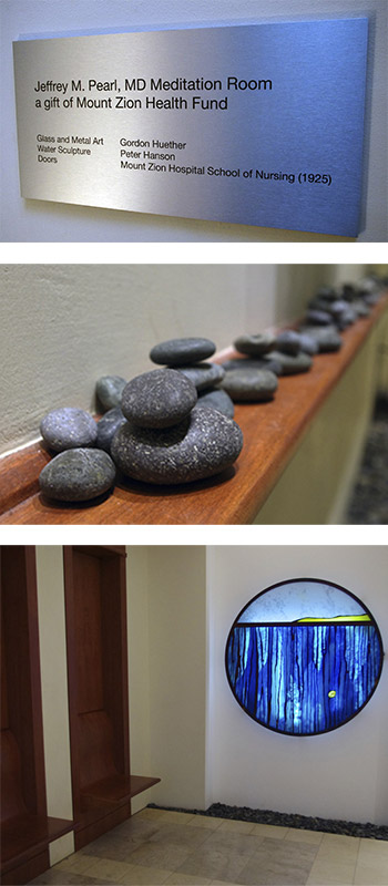 meditation room with stained glass window and stone zen sculpture